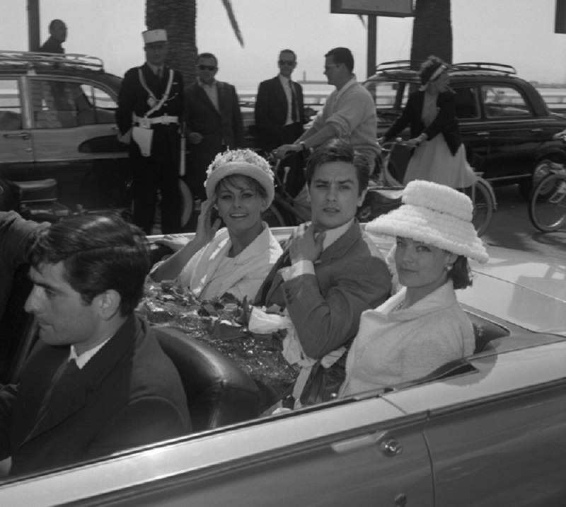 French actor Alain Delon and his counterparts Sophia Loren (L) from Italy and Austria-born German-French actress Romy Schneider arrive May 08, 1962 at Cannes Festival Palace for opening ceremonies of 15th Film Festival. AFP